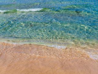 Blue sea water and beautiful orange beach sand - Crete, Greece