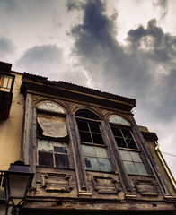 Old abandoned wood house - stormy clouds above