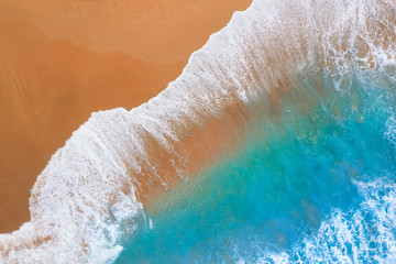 Wall Mural - Beach and blue water with waves