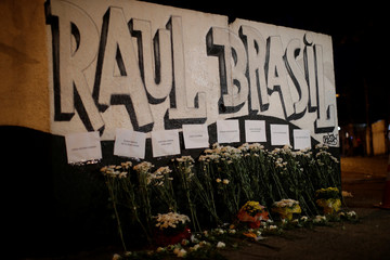 Floral tributes to victims of the shooting at Raul Brasil school are seen in Suzano