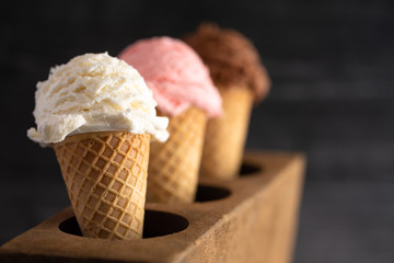Fototapete - A Line of Three Classic Flavors of Ice Cream in a Wooden Sugar Mold