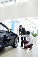 Customer and salesman discussing tires
