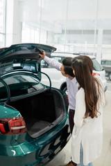 Couple checking car trunk