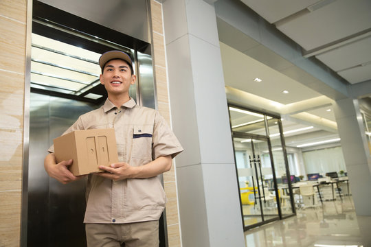 Male Courier with a parcel