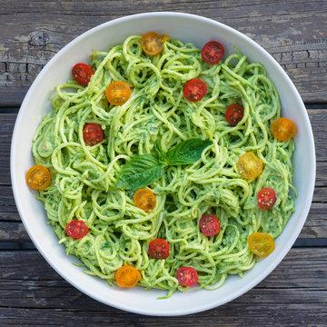 Zucchini noodle pesto pasta with grape tomatoes