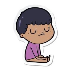 sticker of a cartoon grumpy boy