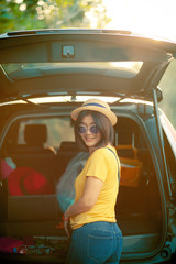 traveller woman toothy smiling happiness emotion standing back of suv car loading belonging for traveling trip