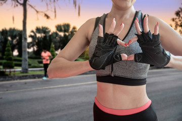 Healthy woman in sport and fitness clothing  exercise and doing heart shape hands sign - Image