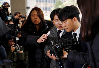 Seungri, a member of South Korean K-pop band Big Bang, arrives to be questioned over a sex bribery case at the Seoul Metropolitan Police Agency in Seoul