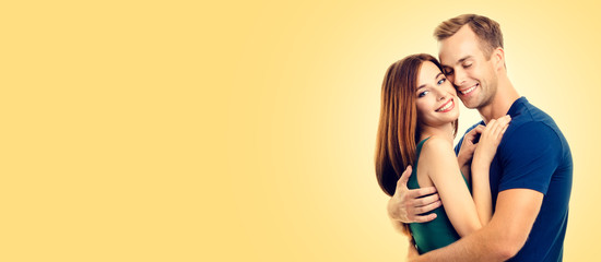 Portrait of young hugging couple, looking at camera with smile. Love, relationship, dating, flirting, lovers, concept. Copy space for some text, or slogan.
