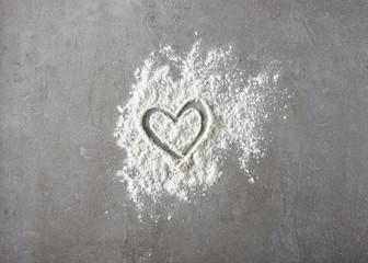 heart shape in flour on grey kitchen table