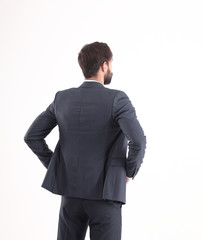 rear view.confident businessman looking at copy space . isolated on white