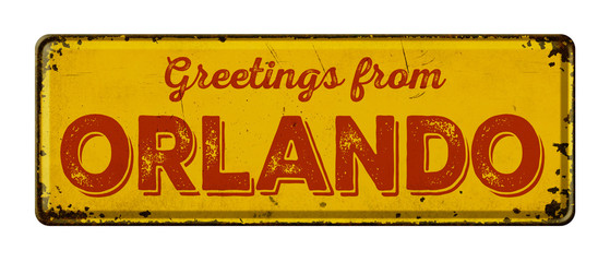 Vintage metal sign on a white background - Greetings from Orlando