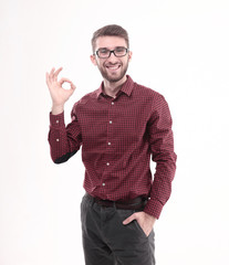 successful young man wearing glasses showing the OK sign.isolated on white