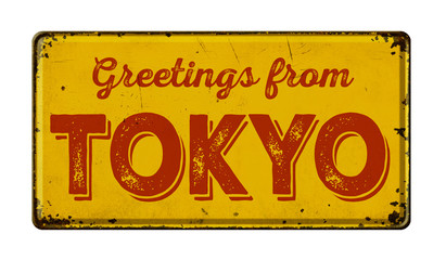 Vintage metal sign on a white background - Greetings from Tokyo