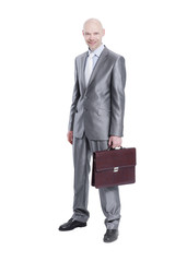 in full growth.handsome businessman with a leather briefcase.is