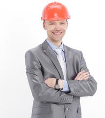 portrait of confident engineer in orange helmet.