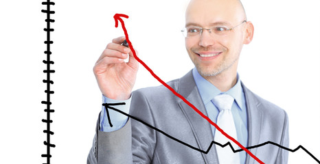 Businessman draws a graph. Isolated on a white background