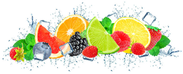 berries and citrus splash water and ice cubes isolated on the white