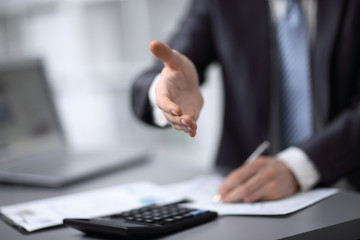 close up. businessman extending his hand to business partner