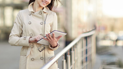businesswoman with a digital tablet, standing on the terrace near the business center