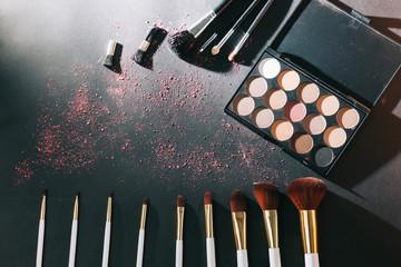 professional makeup set isolated on black background