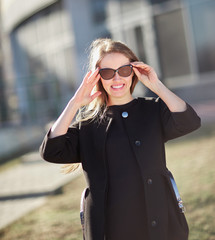 portrait of a modern businesswoman on the background of an office building