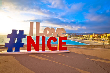 Fotorolgordijn Nice I love Nice tourist sign above Promenade des Anglais in city Of Nice