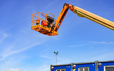 Basket lift on construction site