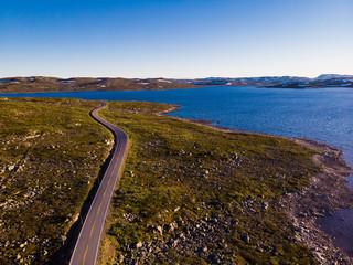 Road crossing Hardangervidda plateau, Norway. Aerial view.