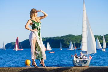 Woman in summer long dress against sea