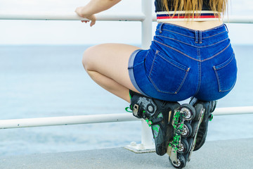 Back view woman wearing roller skates and shorts