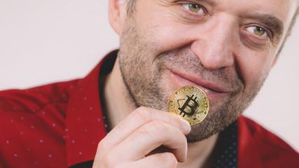 Man holding golden bitcoin