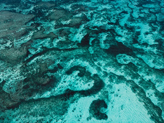 Aerial view with turquoise ocean water. Tropical background from Tahiti islands