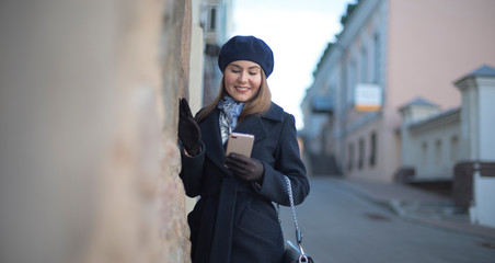 girl with phone in the city.
