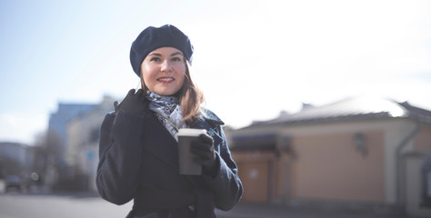 girl in a coat with coffee