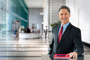 Corporate banking advisor, professional investment manager, businessman, greeting with welcoming smile in building lobby
