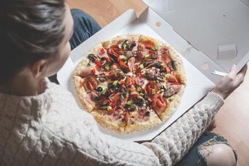 Girl holding pizza box