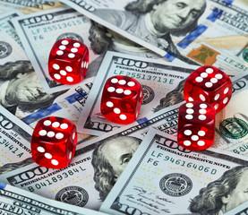 Casino red dices US Dollar bills background
