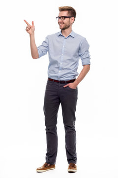 Full length portrait of young man pointing