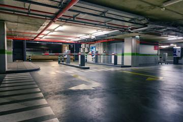Empty underground parking lot industrial background