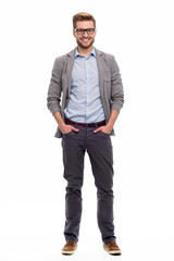 Full length portrait of young man standing on white background