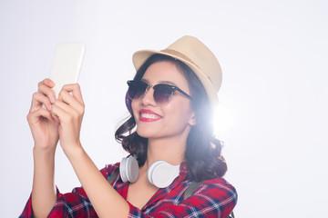 Smiling lovely active asian girl taking selfie photo.