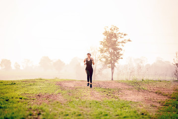 Runner athlete running at green area.Young woman doing yoga exercise yoga master pose Amazing yoga landscape in beautiful and enjoying view, fitness silhouette sunrise jogging workout wellness concept