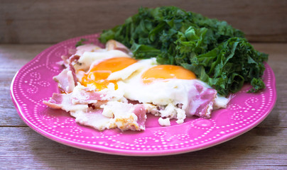 breakfast with eggs, kale and bacon