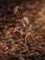 Roasted coffee beans falling down, with copy space