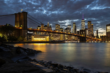 Brooklyn, NY / USA - OCT 19 2018: Lower Manhattan skyline and Brooklyn bridge at sunset
