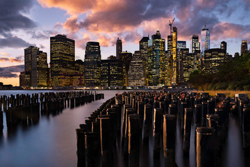 Brooklyn NY / USA - OCT 29 2018: Lower Manhattan skyline at sunset view from Brooklyn Bridge Park