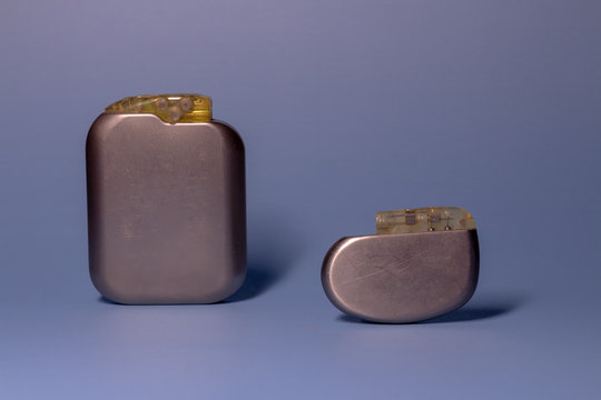 Two old pacemaker collection on a neutral background. Implantable devices in humans.