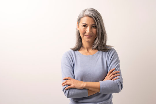 Mongolian Fine Gray Haired Woman on a White Background.